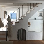 The staircase seen from the kitchen/entrada